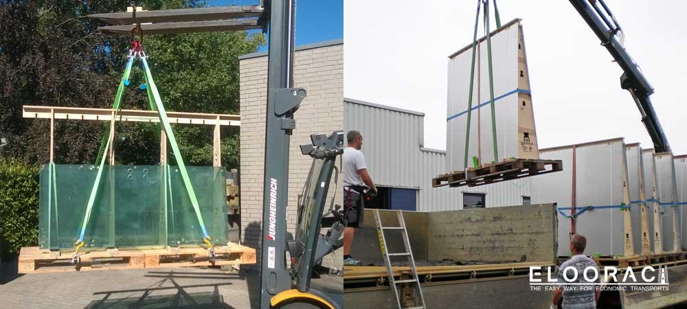 Eloorac Mehrweg Transportgestelle auf Europaletten sind mit Glas und Metallblechen beladen und werden unter Anwendung des Beamer Palettenhebers mit dem Kran angehoben.
