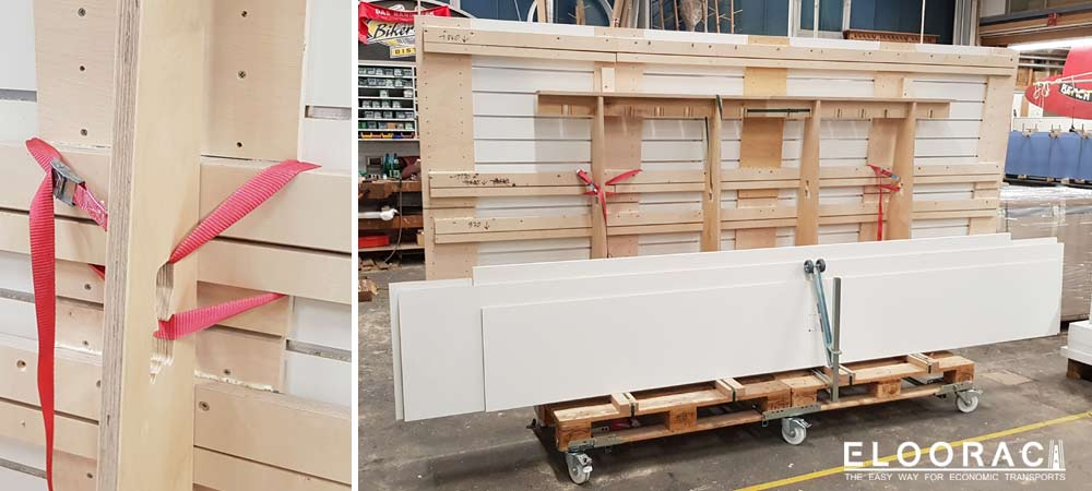 Abbildung eines Eloorac Transportgestells beim Einsatz in einer Tischlerei. Die zu bearbeitenden Spanplatten bzw. Plattenmaterialien können direkt bis an die CNC-Fräse gefahren um dort bearbeitet werden.
