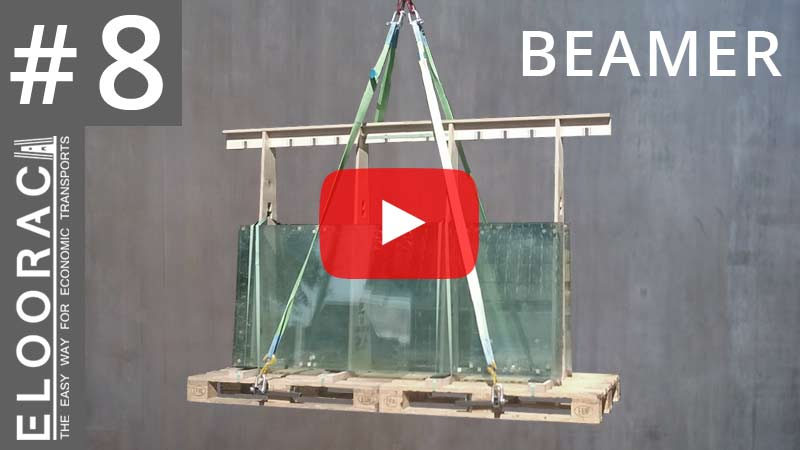 Die Abbildung zeigt ein mit Glas beladenes Eloorac Transportgestell aus Holz. Unter der Paletten wurden die Beamer Paletten Heber durchgeführt und anschließend in Hebegurte eingehangen. Die Palette wurde mit einen Kran angehoben. Krangabel werden hier nicht benötigt.