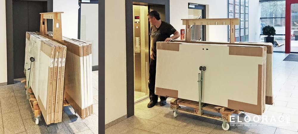 Türen die auf einem Eloorac Transportgestell stehen, werden auf einfache Weise durch die an der Europalette gesteckten Eloowheel Transportrollen von Eloorac, in einen Aufzug geschoben.